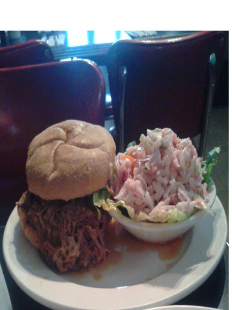 Binnie's pulled pork sandwich with an ample serving of their spicy coleslaw.